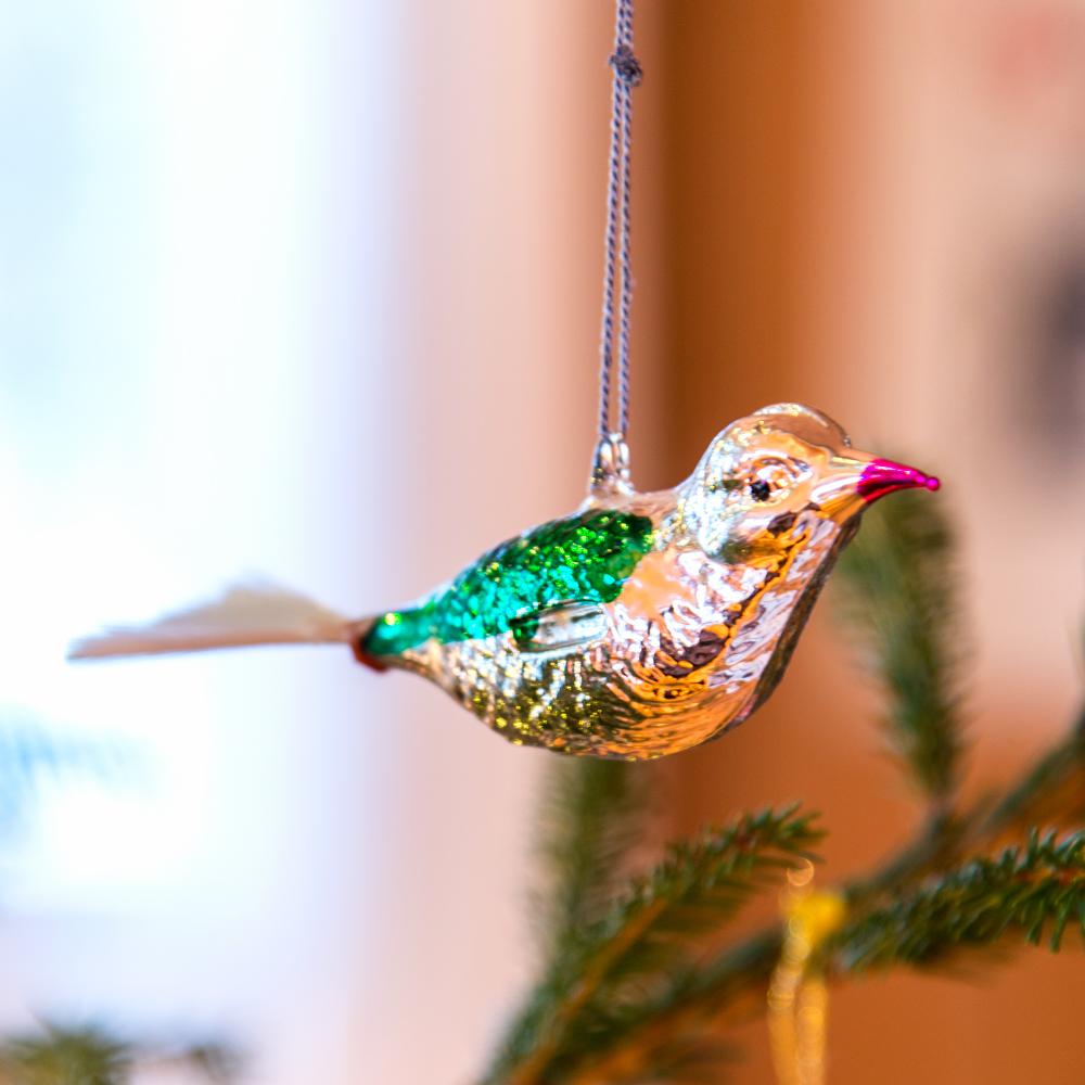 Fugl med hale av glasstråd.